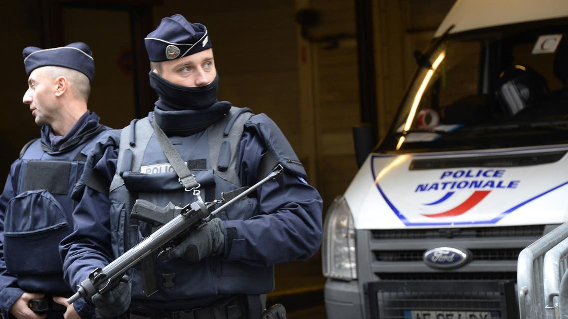 French police officers stand guard in front of the headquarters of French newspaper Liberation. (AFP)