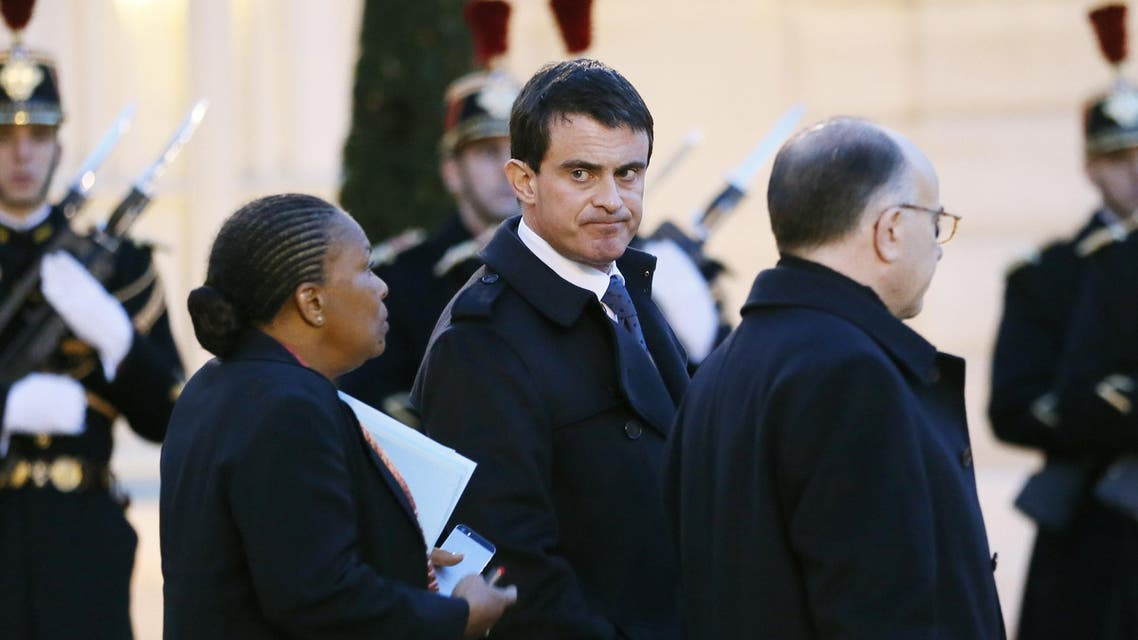 French Prime Minister Manuel Valls (C) stands with French Justice minister Christiane Taubira (L) and French Interior minister Bernard Cazeneuve (R) at the Elysee Palace, on Jan. 8, 2015 (AFP)