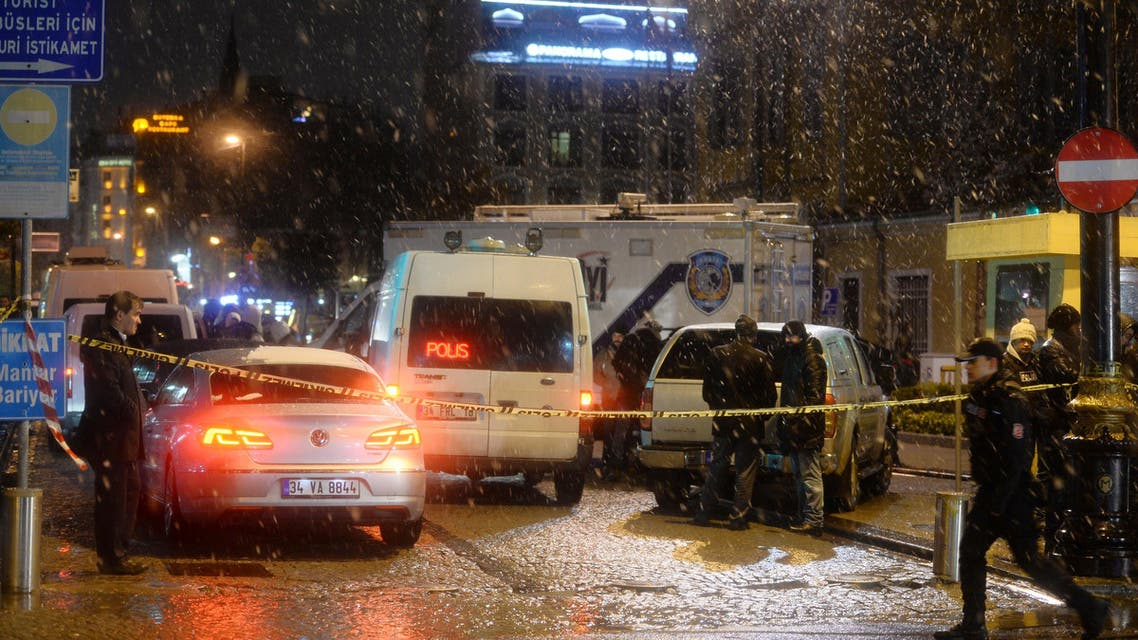 Turkish security gather outside a police station where one police officer was killed and another injured after a suicide bomber blew herself up in Istanbul, Turkey, Tuesday, Jan. 6, 2015. AP