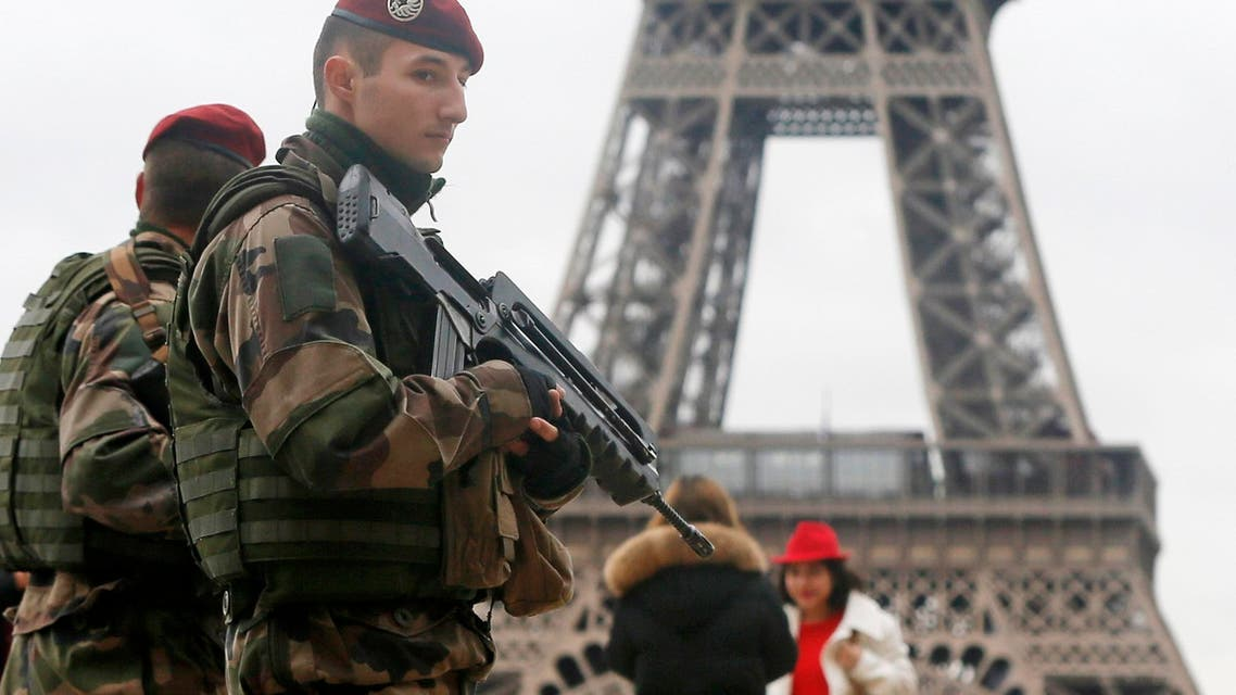 """French soldier patrol near the Eiffel Tower in Paris as part of the highest level of """"Vigipirate"""" security plan after a shooting at the Paris offices of Charlie Hebdo January 9, 2015.  (Reuters)"""