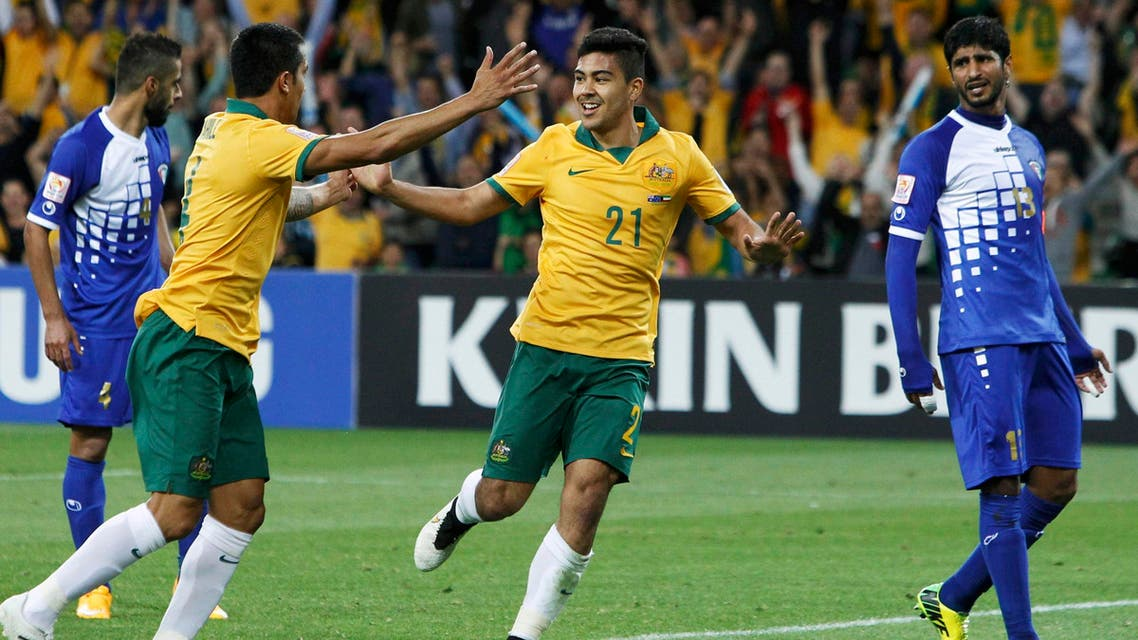 Australia's Massimo Luongo (C) celebrates his goal with teammate Tim Cahill next to Kuwait's Mesaed Alenzi (R) during their Asian Cup Group A soccer match against Kuwait at the Rectangular stadium in Melbourne January 9, 2015. Reuters