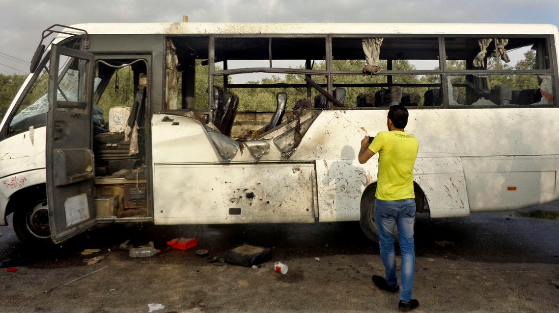 An Egyptian man inspects damages of a bus after an attack in North Sinai's capital el-Arish, Egypt, Monday, July 15, 2013. (File photo: AP)