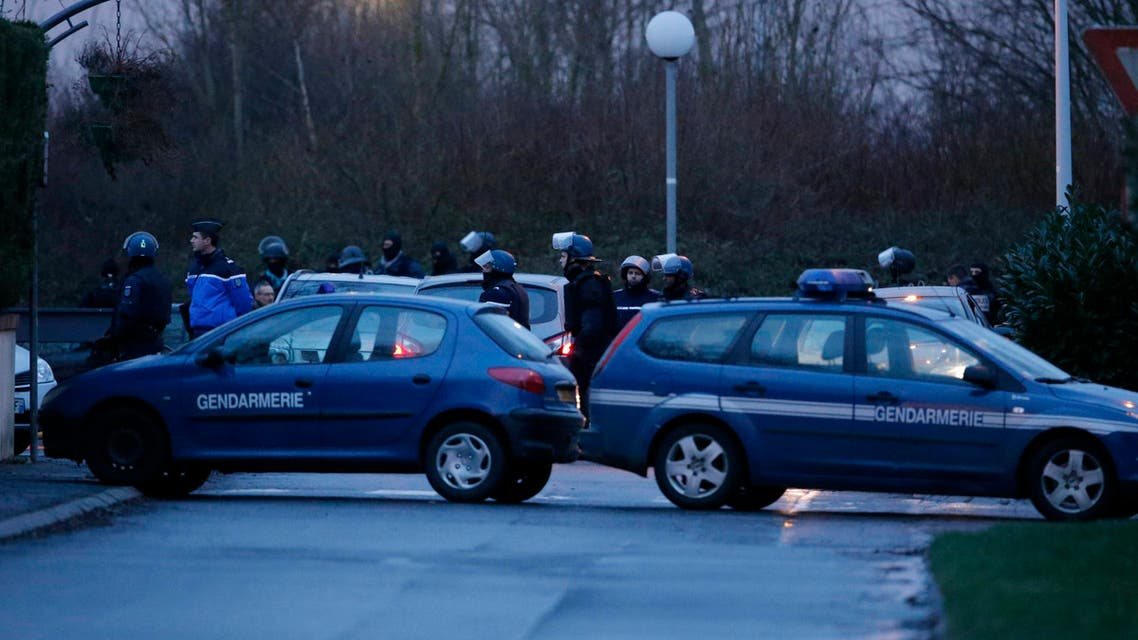 French police special forces advance during the final assault at the scene of a hostage taking at an industrial zone in Dammartin-en-Goele, northeast of Paris January 9, 2015. Reuters