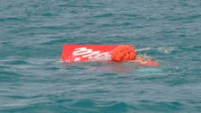 Crashed AirAsia's tail hoisted from Java Sea, no black box found