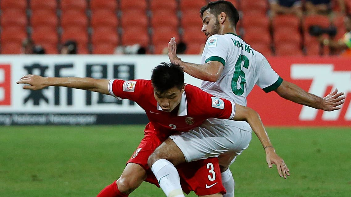 China's Mei Fang (L) and Saudi Arabia's Mustafa Al-Bassas fight for the ball during their Asian Cup Group B soccer match at the Brisbane Stadium in Brisbane January 10, 2015. (Reuters)