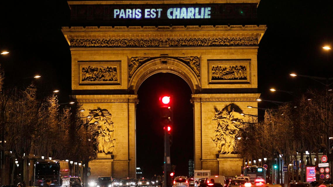 """The message """"Paris is Charlie"""" is projected on the Arc de Triomphe in Paris January 9, 2015, in tribute to the victims following Wednesday's deadly attack. (Reuters)"""