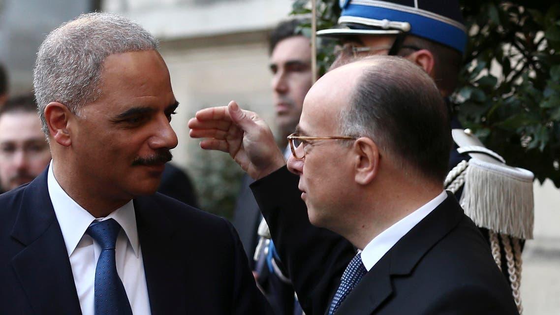 Eric Holder U.S. attorney general France French Interior Minister Bernard Cazeneuve AP
