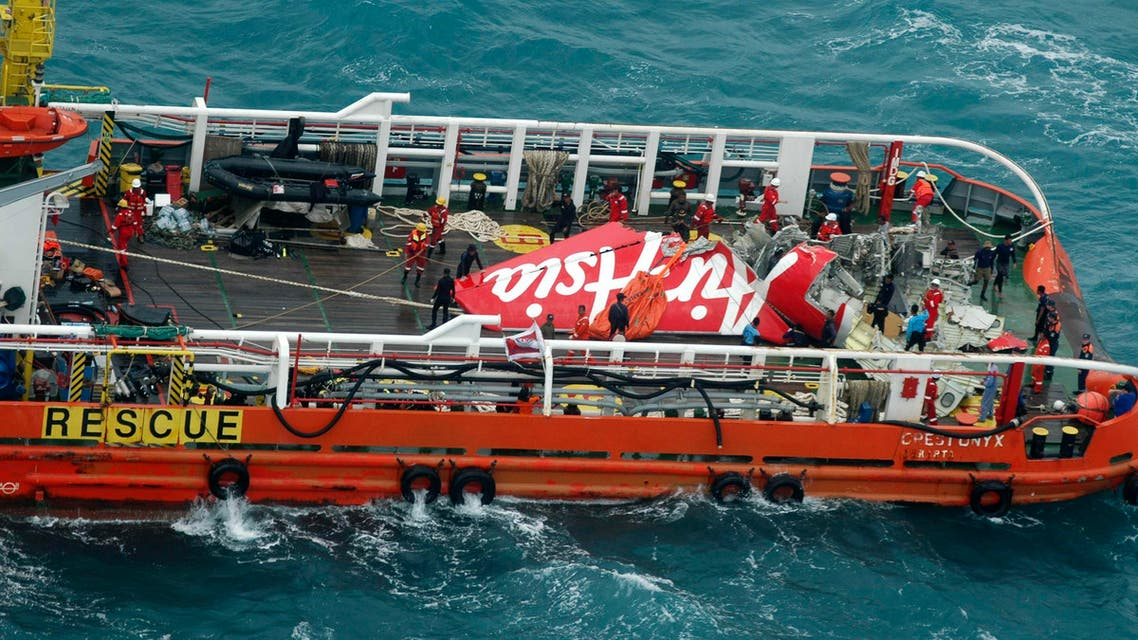 The tail of AirAsia QZ8501 passenger plane is seen on the deck of the Indonesian Search and Rescue ship. (Reuters)