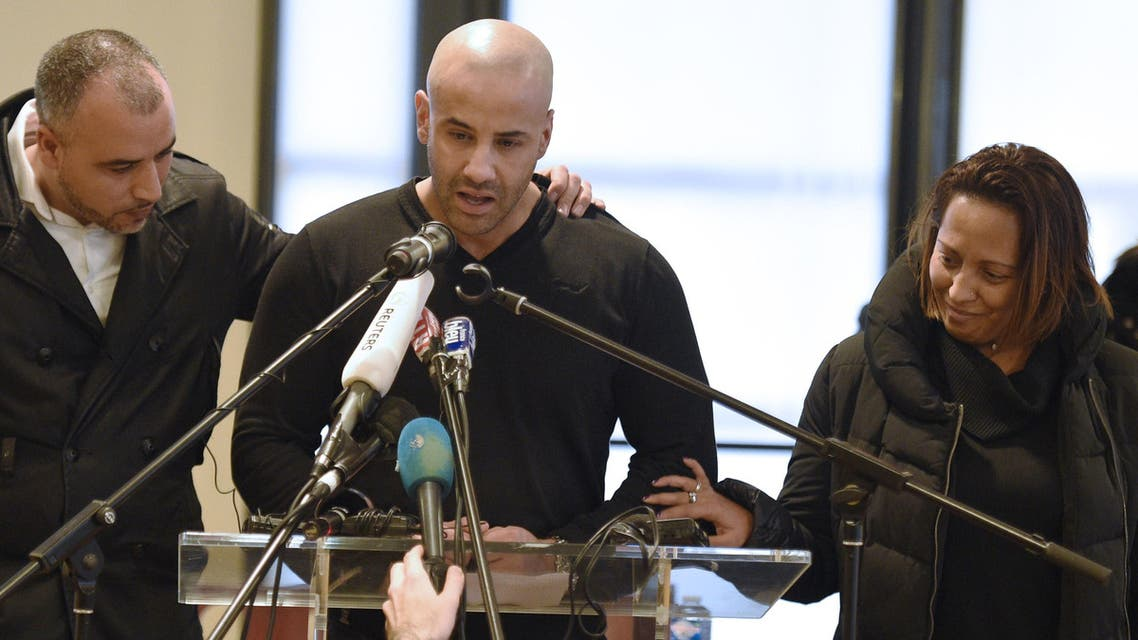 Malek Merabet (C), the brother of slain policeman Ahmed Merabet talks during a press conference in Livry-Gargan, northern Paris suburb, on January 10, 2015. (AFP)