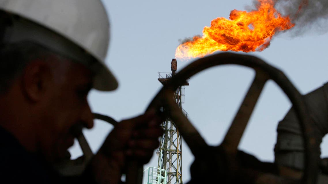An Iraqi worker opens a pipe at Sheaiba oil refinery in Basra in this March 29, 2007 file photo. (Reuters)