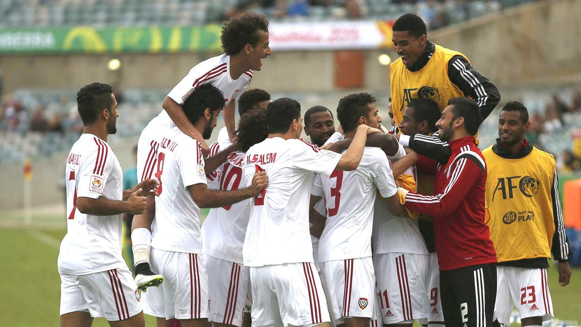 UAE players celebrate goal by UAE's Ahmed Khalil (obscured) during their Asian Cup Group C soccer match against Qatar at the Canberra stadium in Canberra January 11, 2015. (Reuters)