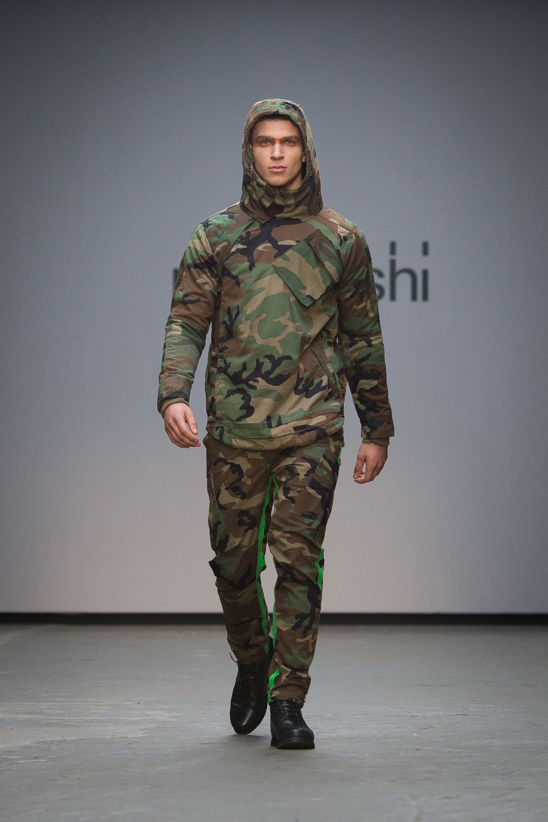 A model presents a creation by Maharishi on the second day of the Autumn/Winter 2015 London Collections: Men fashion event in London on January 10, 2015. (AFP)