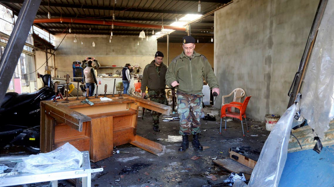 Lebanese Army soldiers walk inside a cafe where a suicide bomb attack took place in Jabal Mohsen, Tripoli January 11, 2015. (Reuters)