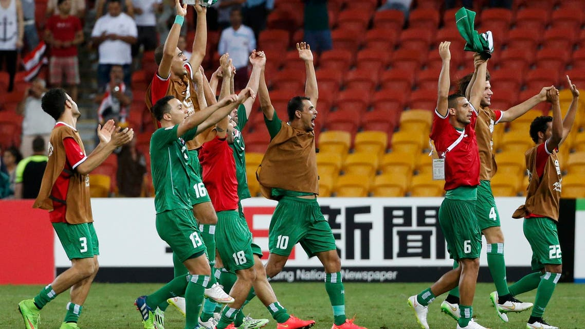 Iraq players celebrate their victory over Jordan after their Asian Cup Group D soccer match at the Brisbane Stadium in Brisbane Jan. 12, 2015.  (Reuters)