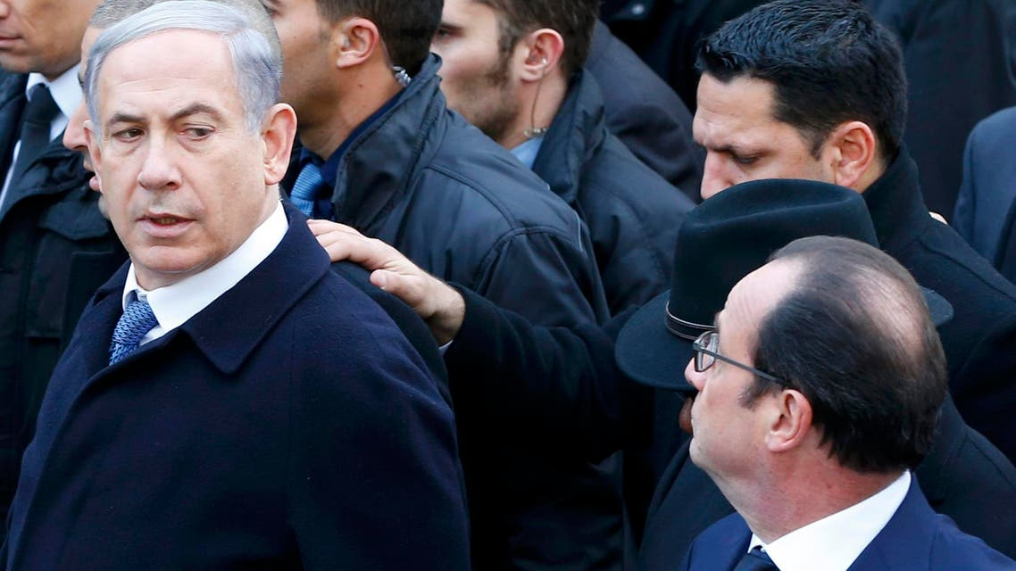 French President Francois Hollande is surrounded by heads of state including Israel's Prime Minister Benjamin Netanyahu as they attend the solidarity march (Marche Republicaine) in the streets of Paris January 11, 2015. (Reuters)