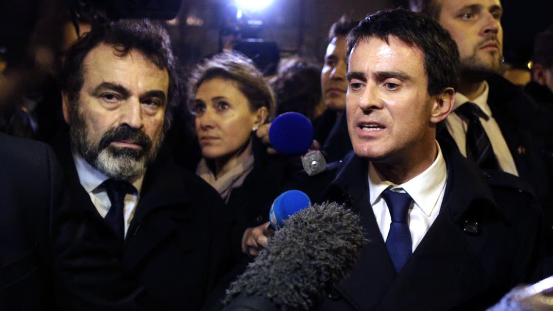 French Prime Minister Manuel Valls (R) speaks to the press on January 10, 2015. (AFP)
