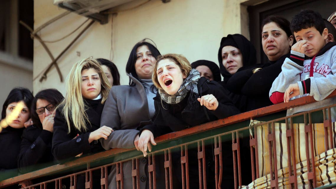 Women mourn men who died inside a cafe where a suicide bomb attack took place in Jabal Mohsen, Tripoli January 11, 2015. (Reuters)