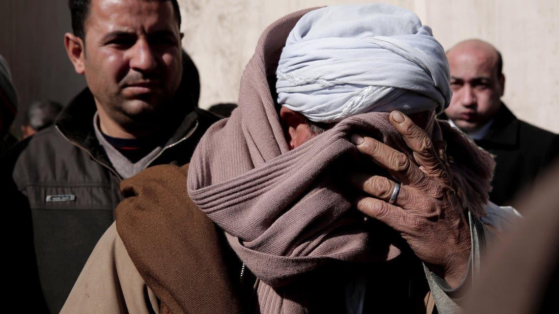 Coptic Christian Samir Mujeed weeps AP
