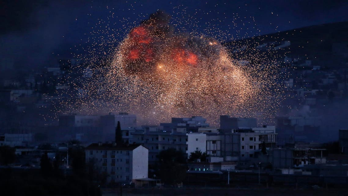 In this Oct. 20, 2014, file photo, thick smoke and flames from an airstrike by the U.S.-led coalition rise in Kobani, Syria, as seen from a hilltop on the outskirts of Suruc, at the Turkey-Syria border. AP