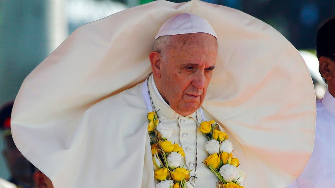 A gust of wind blows the mantle of Pope Francis as he stands next to Sri Lanka's newly elected president Mithripala Sirisena (not seen) at the Colombo airport January 13, 2015. reuters