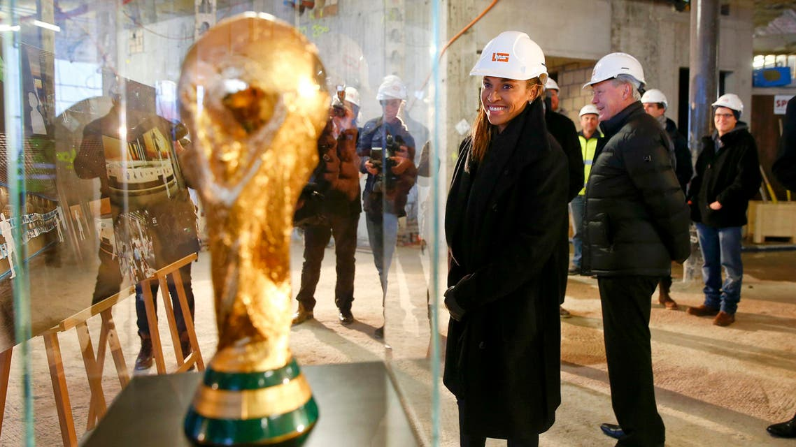 Brazilian soccer player Marta looks at a copy of the FIFA World Cup trophy during her visit to the construction site of the FIFA World Football Museum in Zurich Reuters