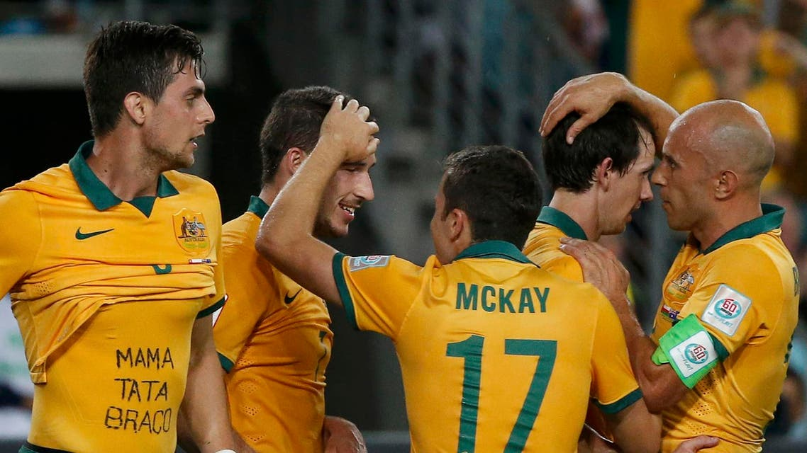 Australia's Tomi Juric (L) celebrates his goal with team mates during their Asian Cup Group A soccer match against Oman at the Stadium Australia in Sydney Jan. 13, 2015. (Reuters)