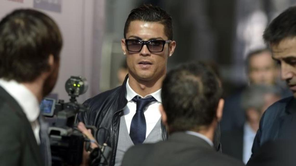 Cristiano Ronaldo arrives to receive the golden boot for La Liga top scorer in Madrid on November 10, 2014. AFP