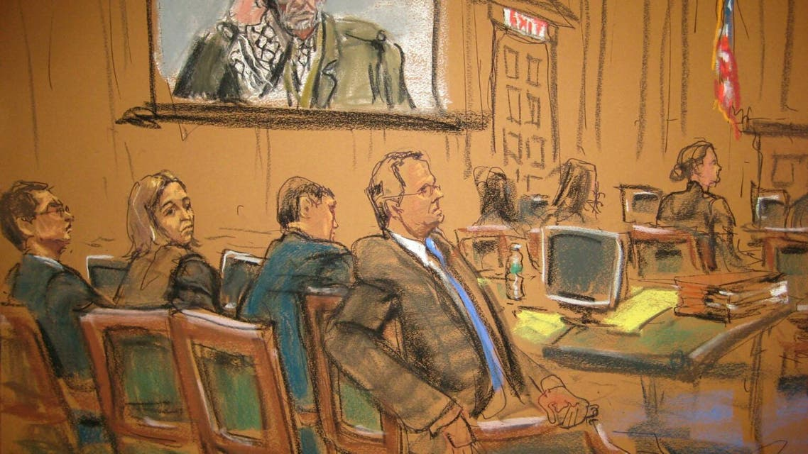 The defense team look on as late Palestinian leader Yasser Arafat is projected onscreen during the plaintiff's opening statements in this court sketch during Sokolow v. Palestine Liberation Organization in New York. Reuters