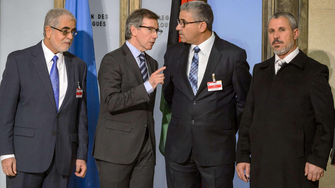 United Nations (UN) special envoy for Libya Bernardino Leon (2nd L) speaks with one the Libya's warring factions representative Fathi Bashagha (2nd R) prior to Libyan talks on January 14, 2015 in Geneva. AFP
