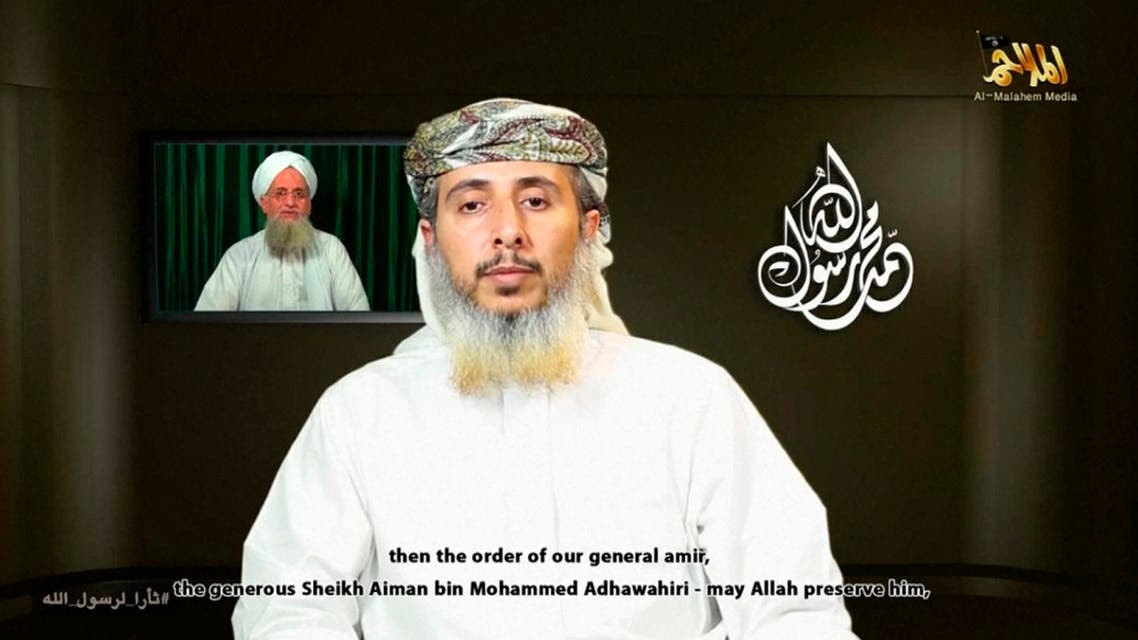 Nasser bin Ali al-Ansi, a leader of the Yemeni branch of al Qaeda (AQAP), speaks as an image of Al Qaeda chief Ayman al-Zawahiri (rear L) is seen in this still image taken from a social media website on Jan. 14, 2015. (Reuters)