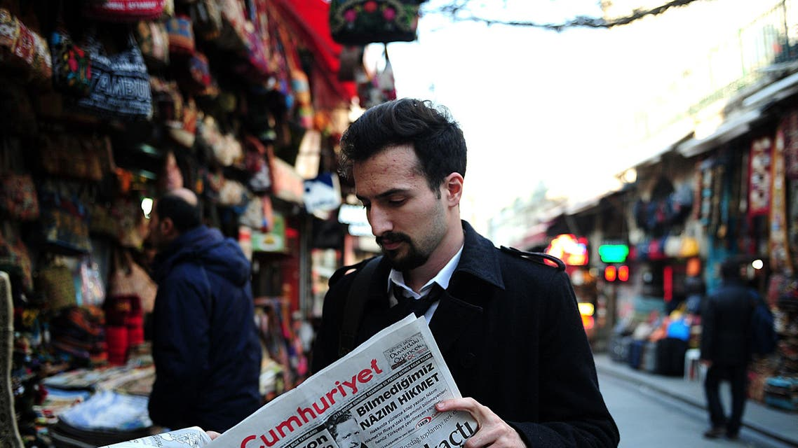 Turkish man reads newspaper AFP