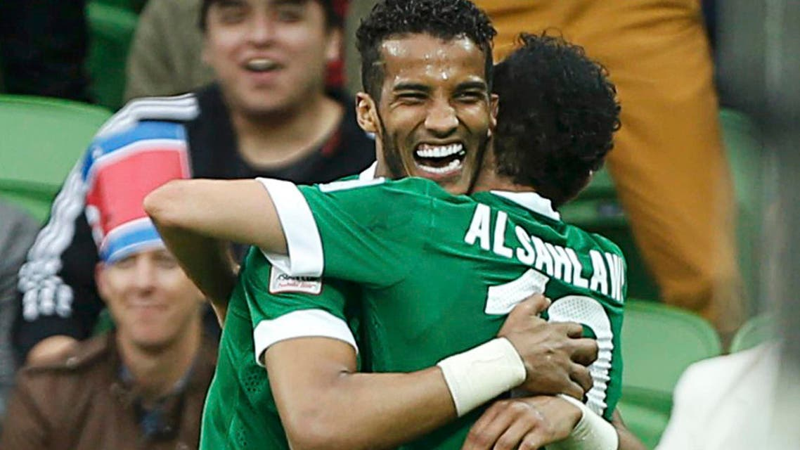 Saudi Arabia's Mohammed Al-Sahlawi (R) celebrates his goal with team mate Naif Hazazi during their Asian Cup Group B soccer match against North Korea at the Rectangular stadium in Melbourne January 14, 2015. Reuters