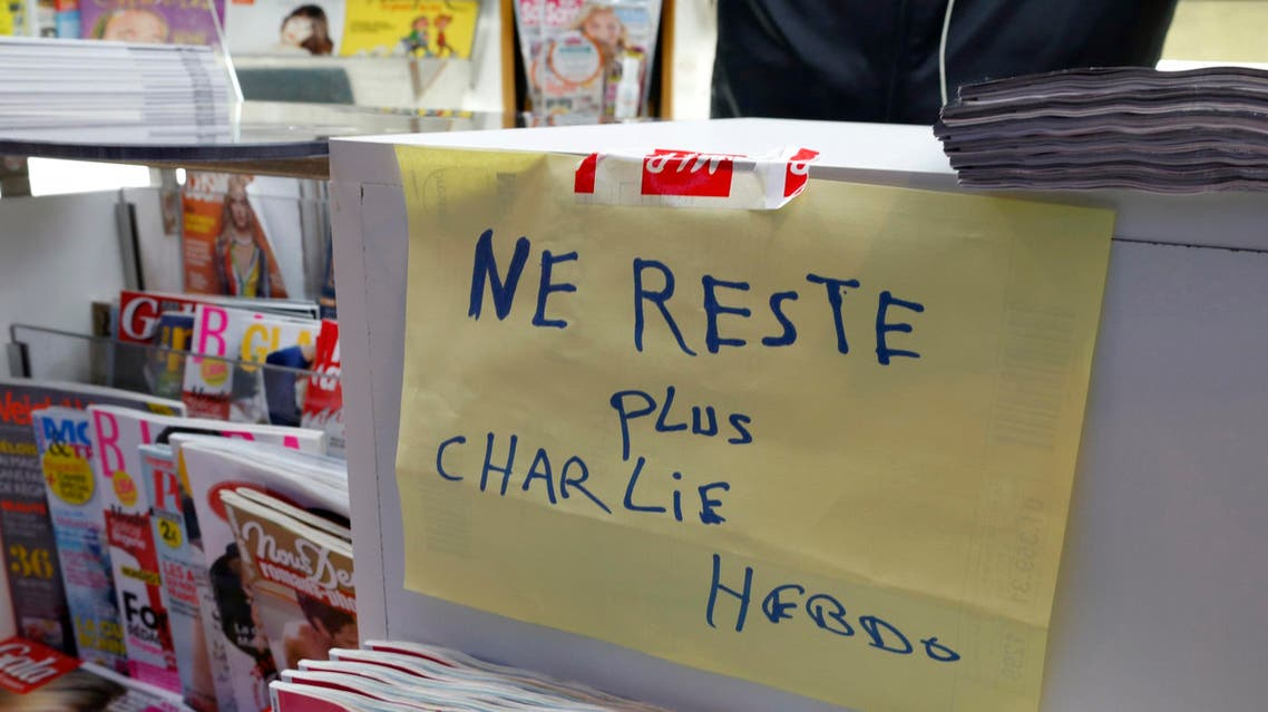 """A handwritten sign at a newsstand, which reads """"No more Charlie Hebdo"""", is displayed after it sold out the limited stock of the satirical newspaper in Paris Jan. 14, 2015. (Reuters)"""