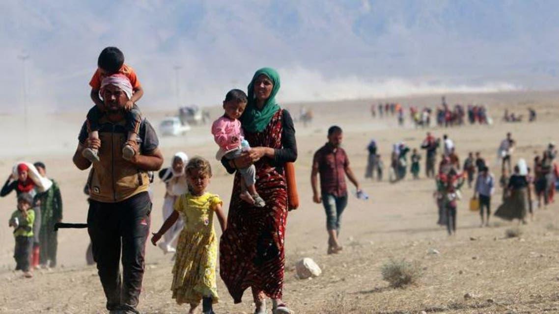 ايزيديون يهربون من داعش ايزيديات العراق