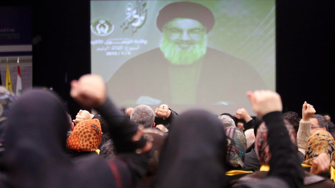 Lebanon's Hezbollah leader Sayyed Hassan Nasrallah addresses his supporters via a screen during a ceremony celebrating the birthday anniversary of Prophet Mohammed in Beirut's southern suburbs, Jan. 9, 2015.  (Reuters)