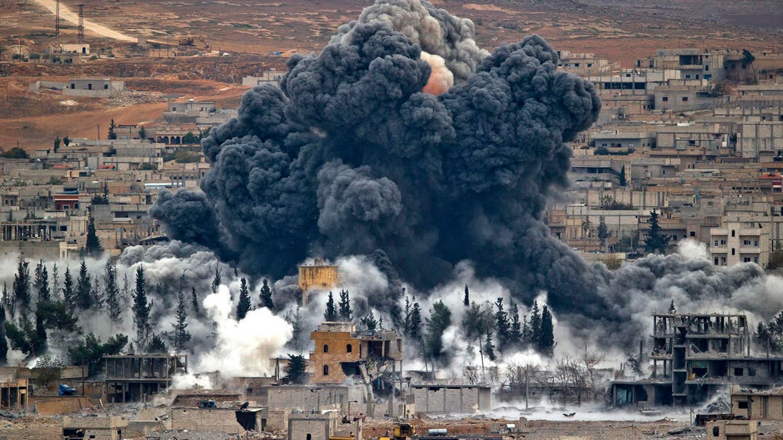In this Monday, Nov. 17, 2014 file photo, smoke rises from the Syrian city of Kobani, following an airstrike by the U.S.-led coalition, seen from a hilltop outside Suruc, on the Turkey-Syria border. (AP)
