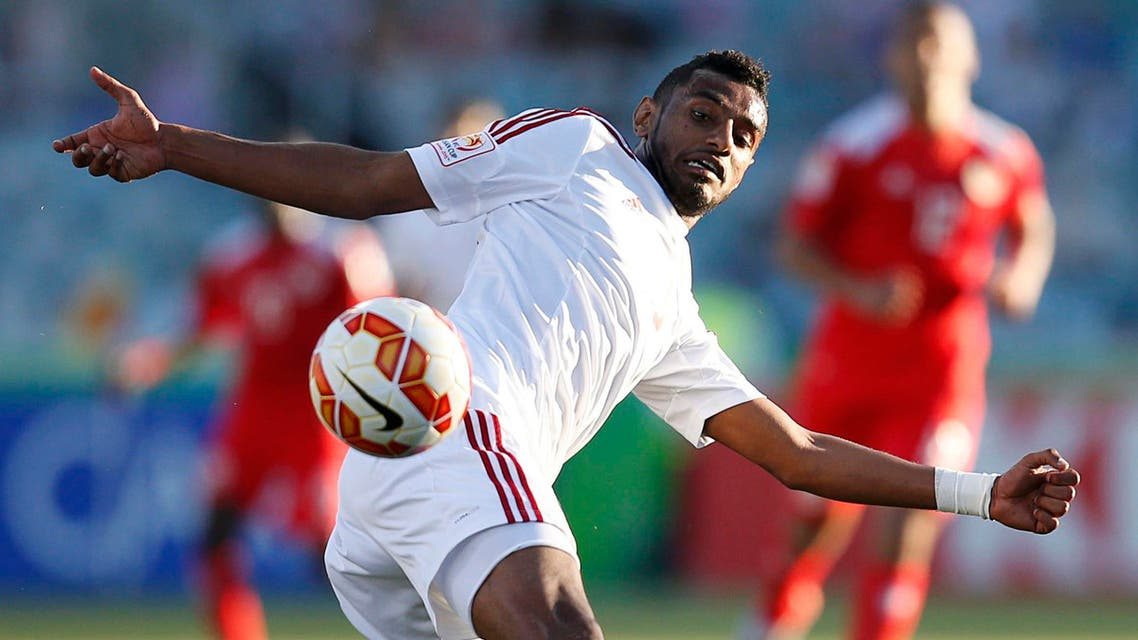 UAE's Mohamed Ahmad Gharib attempts to clear the ball during their Asian Cup Group C soccer match against Bahrain at the Canberra stadium in Canberra Jan. 15, 2015.  (Reuters)