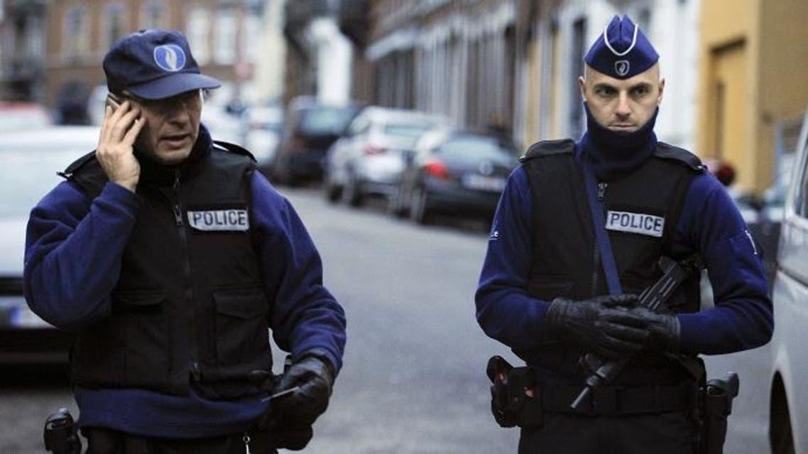 Policemen stand guard at Colline street in Verviers, eastern Belgium, on Jan. 16, 2015. (AFP)