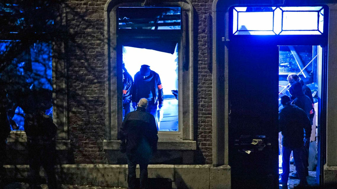 Belgian police inspect an apartment in central Verviers, a town between Liege and the German border, in east Belgium Jan. 15, 2015. (Reuters)