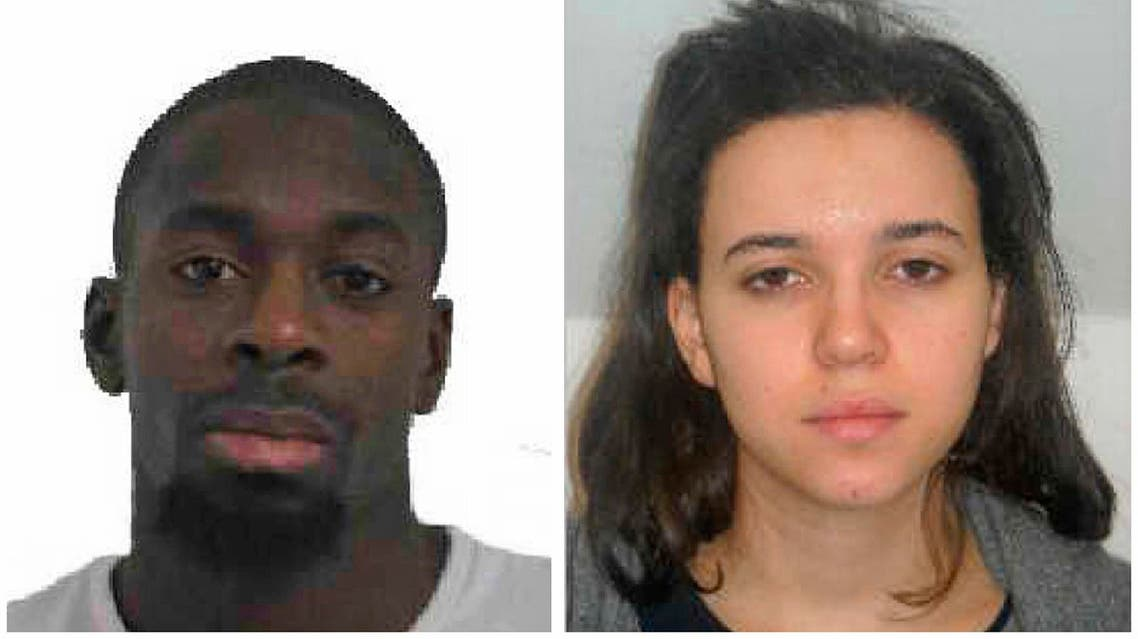 Amedy Coulibaly, left, and Hayat Boumddiene, two suspects named by police as accomplices in a kosher market attack on the eastern edges of Paris on Friday, Jan. 9, 2015. AP