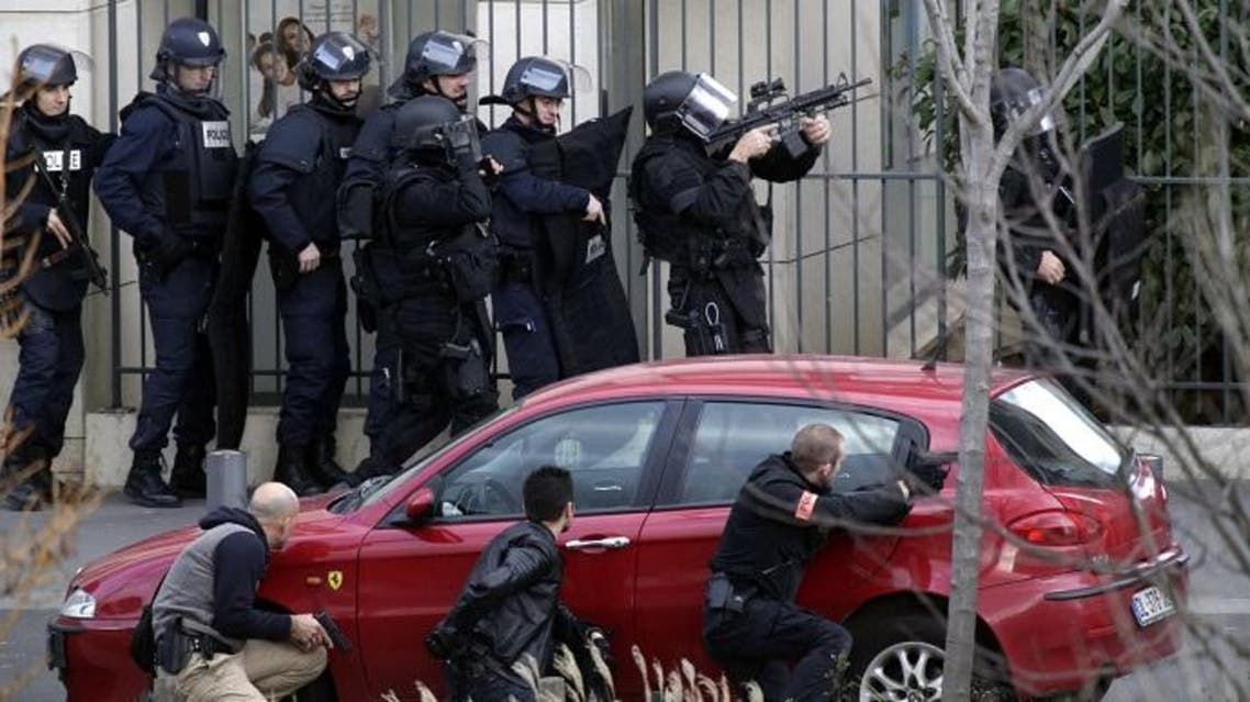 French Research and Intervention Brigades (BRI) policemen officers prepare near the post office where an armed man is holed up with two hostages, on Jan. 16, 2015 in Colombes. (AFP)