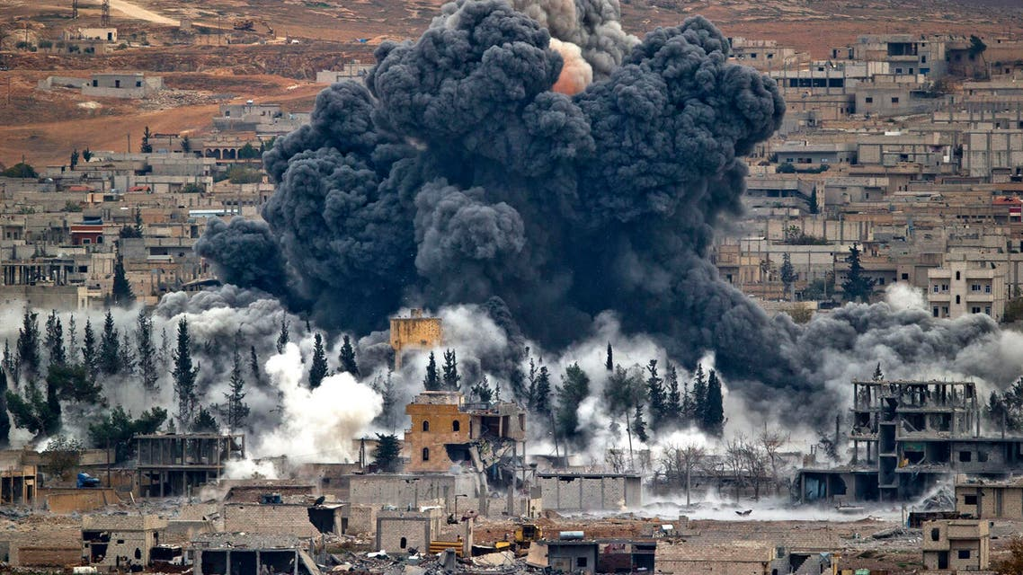 In this Monday, Nov. 17, 2014 file photo, smoke rises from the Syrian city of Kobani, following an airstrike by the U.S.-led coalition, seen from a hilltop outside Suruc, on the Turkey-Syria border. AP