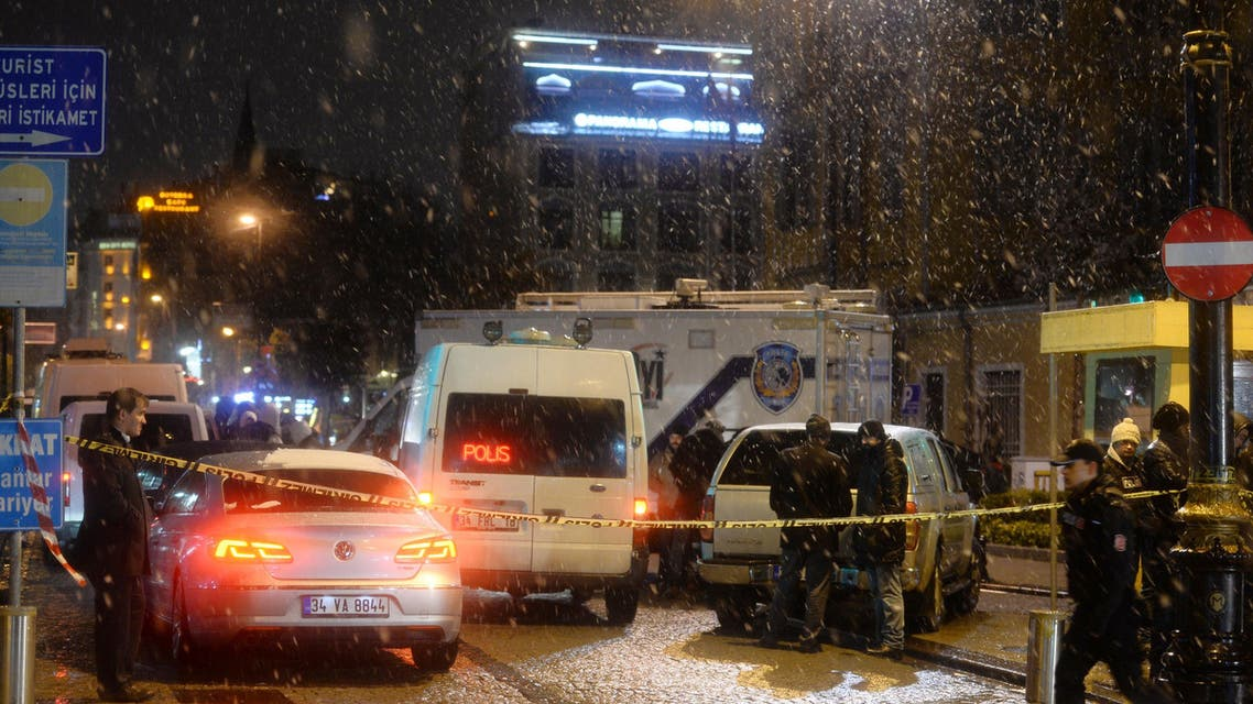 Turkish security gather outside a police station where one police officer was killed and another injured after a suicide bomber blew herself up in Istanbul, Turkey, Tuesday, Jan. 6, 2015.  (AP)