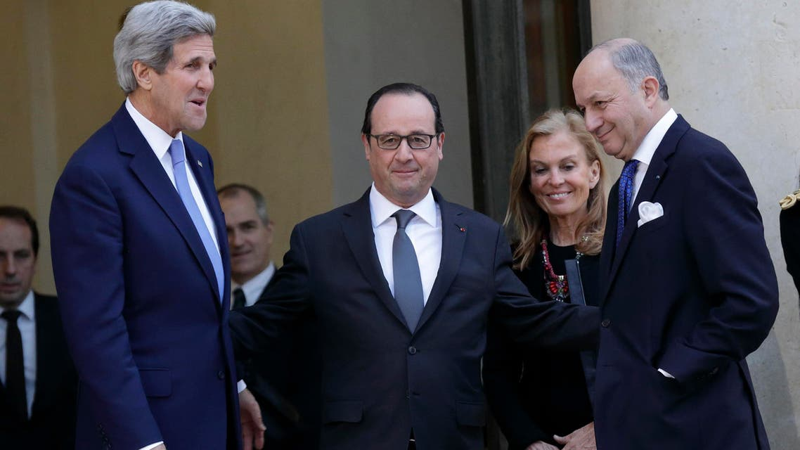 French President Francois Hollande (2ndL) talks with U.S. Secretary of State John Kerry after their meeting attended by US Ambassador to France Jane Hartley (3rdL) and French Foreign Affairs minister Laurent Fabius (R) at the Elysee Palace in Paris Jan. 16, 2015. (Reuters)