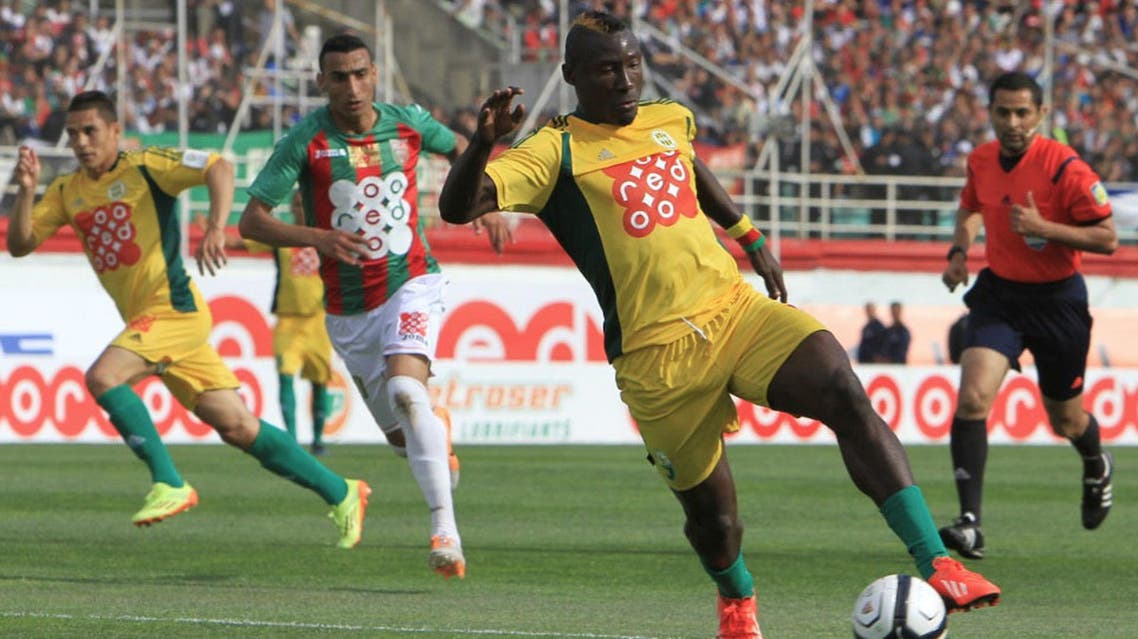 n this photo dated May 2, 2014, JS Kabylie striker Albert Ebosse of Cameroon controls the ball during the final of the Algerian soccer Cup in Blida near the Algerian capital, Algiers. AP