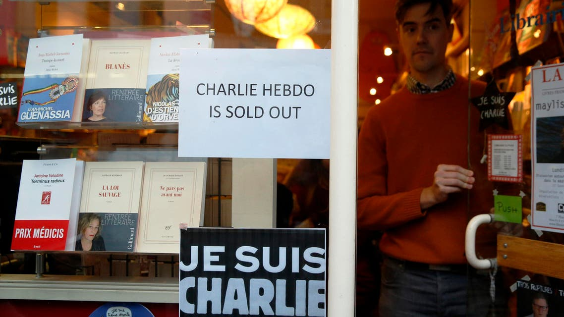 A sign is fixed into a shop window as copies of Charlie Hebdo sell out in London January 16, 2015.  (Reuters)