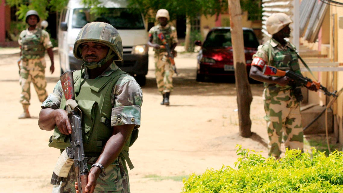 Nigerian soldiers stand guard at the offices of the state-run Nigerian Television Authority in Maiduguri, Nigeria. (AP)
