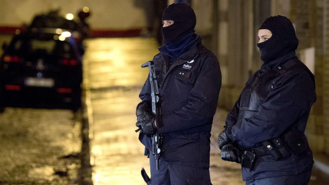Armed police officers wearing balaclavas stand near a cordoned off section of Colline street in Verviers, eastern Belgium, on January 15, 2015, after two suspects were killed during an anti-terrorist operation. AFP