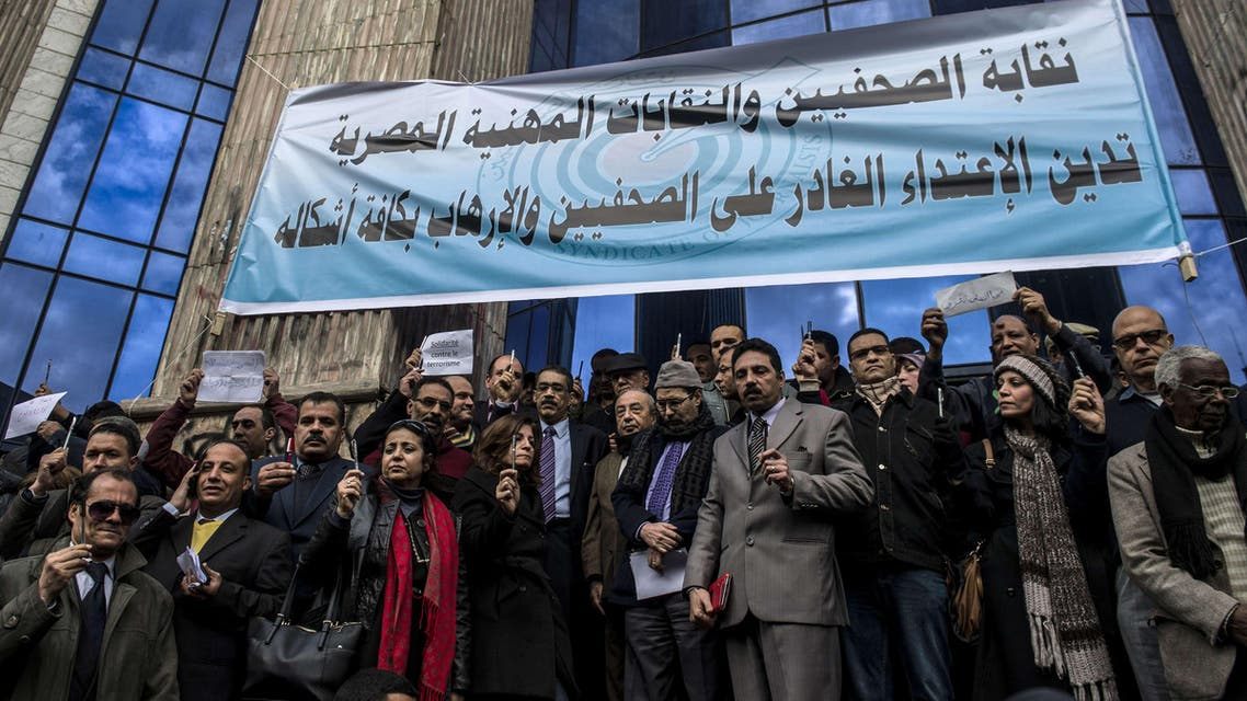 Egyptian journalists hold up pens in a silent protest outside Egypt's syndicate of Journalists in Cairo on January 11, 2015, to protest against the attack on the French satirical magazine Charlie Hebdo's office in Paris which killed 12 people. AFP
