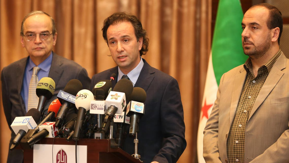 In this picture taken on January 5, 2015, released by the Syrian National Coalition Media Office, Khaled Khoja, the head of the Syrian National Coalition, center, speaks during a press conference, as the former Secretary General Nasr Hariri, right, and the former president Hadi Bahra, left, stand next to him, in Istanbul, Turkey. AP